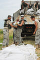 FEMA - 36154 - Missouri National Guard stack sandbags on a levee.jpg
