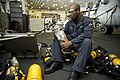 Flickr - Official U.S. Navy Imagery - A Sailor refills a self-contained breathing apparatus..jpg