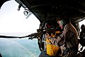 Flickr - Official U.S. Navy Imagery - Navy admiral fires a MK-11 sniper rifle from an MH-60S Sea Hawk helicopter.jpg