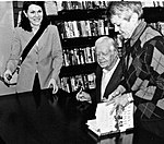 Fmr. President Jimmy Carter signs a book for me.jpg