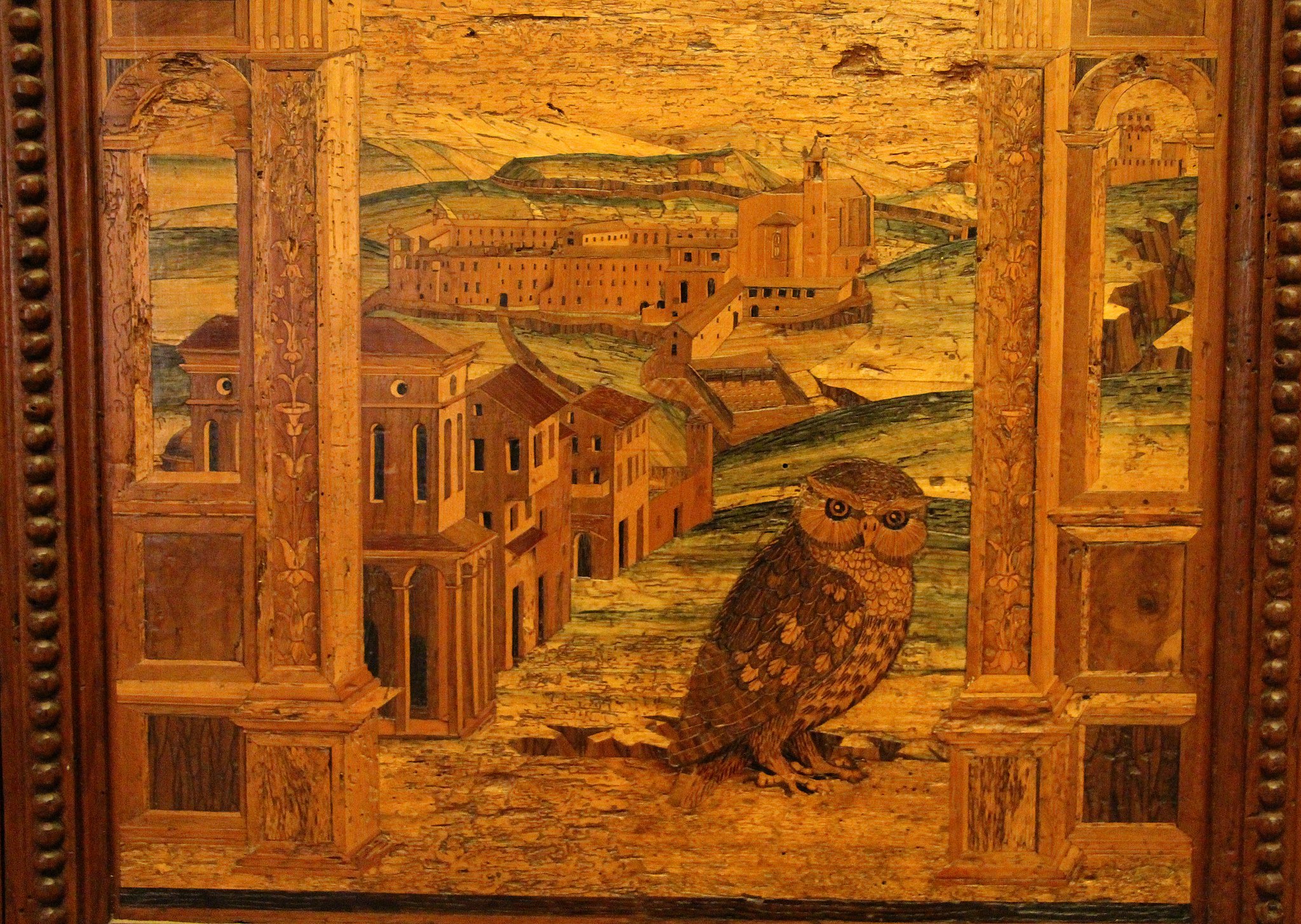 Fra Giovanni da Verona (attr.), armadio intariato con vedute di Monteoliveto, 1502