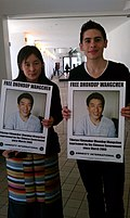 Dhondup Wangchen's wife Lhamo Tso (left) protesting on his behalf
