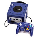 Purple video game console with attached controller