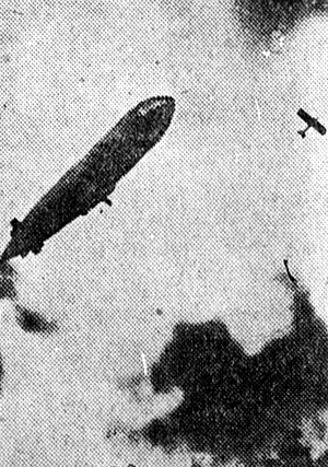 1915 in aviation - A German airship and a French aeroplane battle in the sky, 1915.