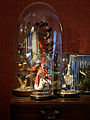 Glass display domes with Victorian bird taxidermy and dolls.jpg