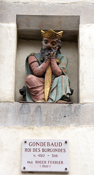 Gundobad - Whimsical statuette of Gundobad on a facade of the Place du Bourg-de-Four in Geneva, Switzerland.