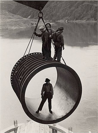 Grand Coulee Dam - Workers installing a penstock section