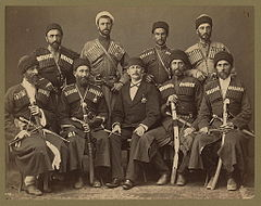 Group portrait of eight Circassian men in uniform, with another man, possibly an Ottoman official.jpg