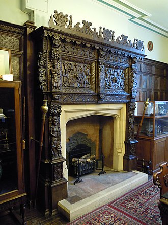 Guildhall, Barnstaple - The ornately carved fireplace in the panelled Dodderidge Room