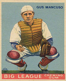 A baseball-card image of a man in a white baseball uniform wearing shin pads on his legs, a chest protector, and a catcher's mitt on his left hand