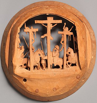 """Gothic boxwood miniature - The reverse of one of the four discs making up the interior Crucifixion relief from """"Half of a Prayer Bead with the Crucifixion"""" (17.190.473b), early 16th century, Netherlandish. Height: 5.7 cm. Metropolitan Museum of Art, New York"""