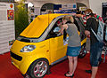 Half of a Smart car at GamesCom - Flickr - Sergey Galyonkin.jpg