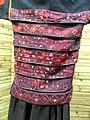 Hani woman cross-stitched dress detail - Yunnan Nationalities Museum - DSC04224.JPG