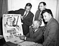 Harry S. Truman, Dr. John L. Childs, Alex Rose, and David Dubinsky look over a campaign poster urging people to register to vote, 1944. (5279453872).jpg