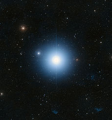 A large blue star in an ocean of other stars taken by telescope