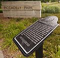 Heritage-Plaque-Piccadilly-Park-Ordnance-Survey-Stone-With-Piccadilly-Park-Sign-London-Ontario-Canada.jpg