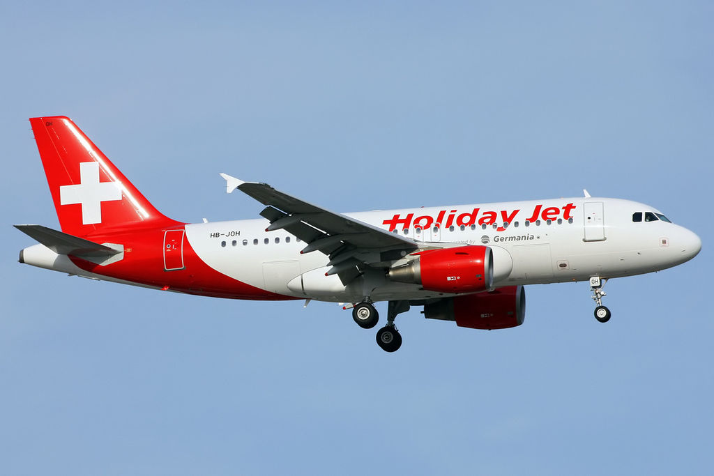 1024px-Holiday_Jet_Airbus_A319-112_on_final_approach_at_Antalya_Airport.jpg