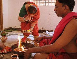 Daivadnya Brahmin -  A couple performing religious rituals