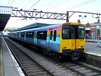 National Express East Anglia -  One liveried Class 315 at Hackney Downs station in August 2007