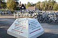 "Hundreds of ""free for use"" white bicycles at central square Hoge Veluwe. In front a giant ""mushroom""road sign - panoramio.jpg"