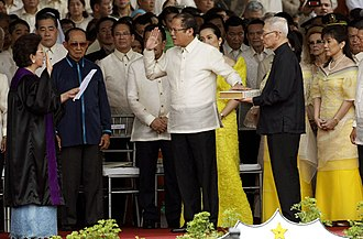 Benigno Aquino III - Benigno Aquino III takes the oath of office as the 15th President of the Philippines before Associate Justice Conchita Carpio-Morales at the Quirino Grandstand on June 30, 2010.