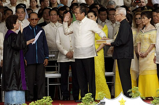 Benigno Aquino III takes the oath of office as the 15th President of the Philippines before Associate Justice Conchita Carpio-Morales at the Quirino Grandstand on June 30, 2010. Inauguration of Benigno Aquino III.jpg