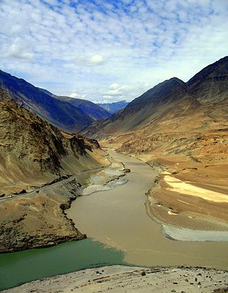 Zanskar River - The confluence of the Zanskar River (from top) and the Indus (bottom flowing from left to right) is 3 km southeast of Nimmu village in Ladakh.