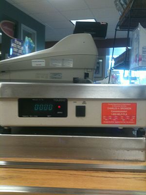 Weighing scale - Scales used for trade purposes in the state of Florida, as this scale at the checkout in a cafeteria, are inspected for accuracy by the FDACS's Bureau of Weights and Measures.