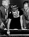 Irene Dunne writing her signature in cement.jpg