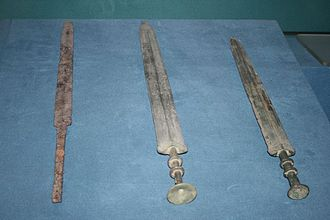 Military history of China before 1911 - An iron sword and two bronze swords from the Warring States period (403–221 BC)