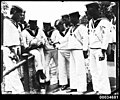 Japanese sailors from the Imperial Japanese Naval Squadron handle a turtle at Taronga Zoo, 28 January 1924 (7237426196).jpg