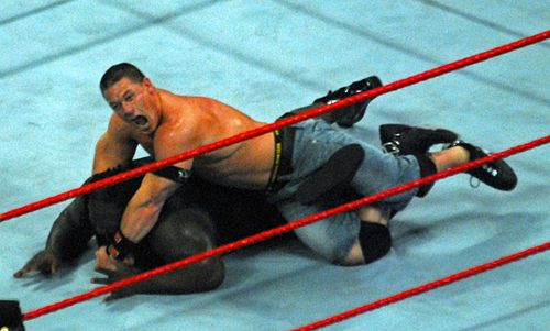 John Cena performs his STF submission hold against Mark Henry John Cena performs STF against Mark Henry.jpg