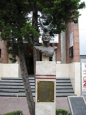 "Yaqui music - Sculpture in memory of deer dancer Jorge Tyler on display on Genova Street in the ""Zona Rosa"" in Mexico City."