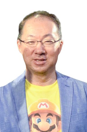 Super Mario Bros.: The Lost Levels - The game's director, designer, and composer pictured together in 2015: Takashi Tezuka, Shigeru Miyamoto, and Koji Kondo
