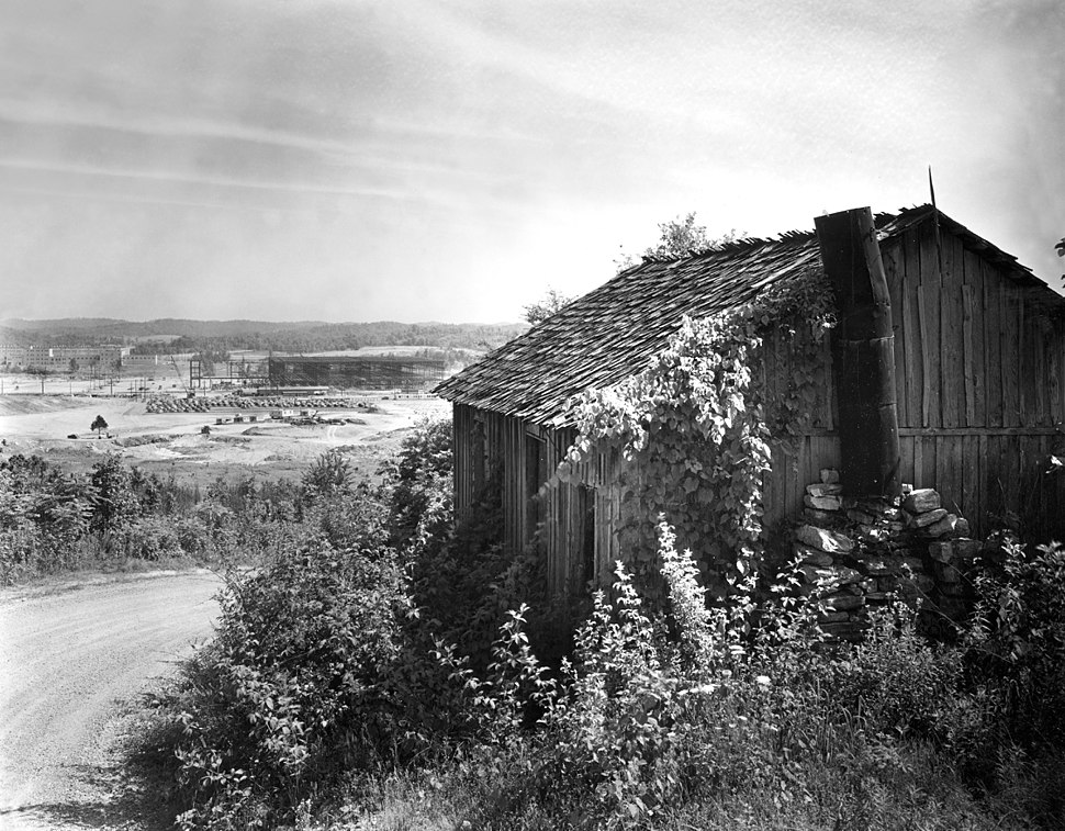 K-25 under construction with one of original houses Oak Ridge Tennessee1942