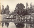 KITLV 100429 - Unknown - Indian company in the pavilion of a proa, presumably at Srinagar in Kashmir in British India - Around 1870.tif