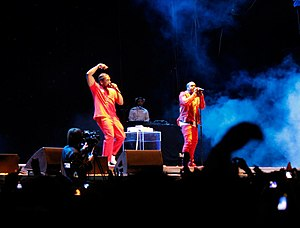 """Pusha T - Pusha T performing """"Runaway"""" with West at Lollapalooza Chile in Santiago, 2011."""