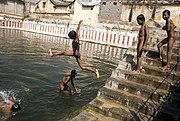Boys skinny dipping in a sacred tank of water in Tiruvanamalai, India.