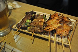 Kushiyaki- pork-wrapped asparagus, wings.jpg