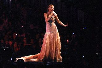 """Impossible Princess - Minogue performing """"Dreams"""" during Showgirl: The Greatest Hits Tour (2005). Impossible Princess takes its title after a line in said song."""