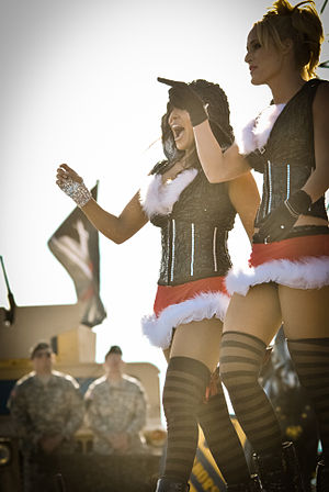 Layla El - Layla (left) with Michelle McCool as LayCool at the 2010 Tribute to the Troops event in Fort Hood, Texas