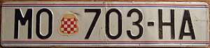 Croatian Republic of Herzeg-Bosnia - License plate of Mostar with the Coat of arms of Herzeg-Bosnia