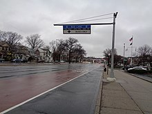 Offset, red-painted bus lane on Woodhaven Boulevard, north of Metropolitan Avenue, in Queens