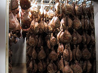 Ham - Hams aging in an atmospherically controlled storage room in Mazerolles, Béarn, Pyrénées-Atlantiques