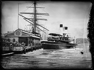 Port Jackson and Manly Steamship Company - A paddle steamer approaches the wharf