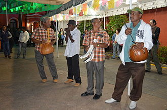 Afro-Mexicans - Musicians accompanying the dancers. Among the instruments used are the quijada and bote drum, both characteristic of the Costa Chica.