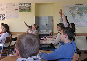 Pupils in a traditional classroom situation si...