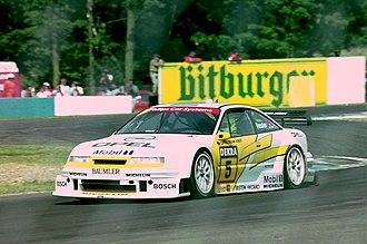 Manuel Reuter - Manuel Reuter - Opel Team Joest - Opel Calibra V6 exits The Esses, Donington Park 1994 DTM