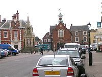 Leighton Buzzard Market Square. 19th century Town Hall (with clock tower) and the 15th century pentagonal market cross