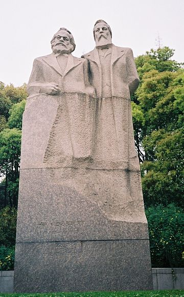 A monument dedicated to Karl Marx (left) and Friedrich Engels (right) in Shanghai, China Marx et Engels à Shanghai.jpg